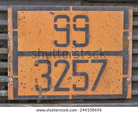 Orange plate with hazard identification number on bitumen tank. Vehicles with tanks carry the HIN (hazard identification number) to identify the risk of products being transported. - stock photo