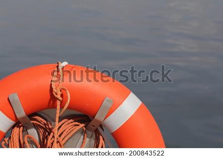 Orange pool float, life preserver - stock photo
