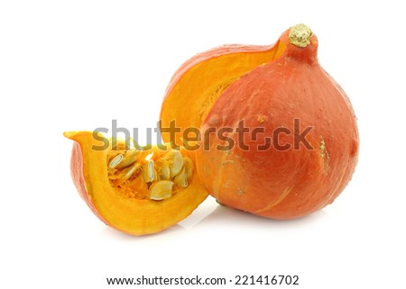 orange pumpkin cut open on a white background - stock photo