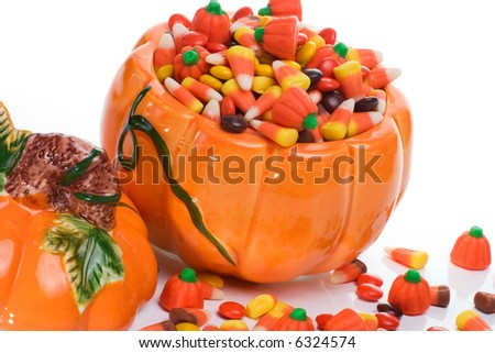 Orange pumpkin filled with delicious Halloween candy - stock photo
