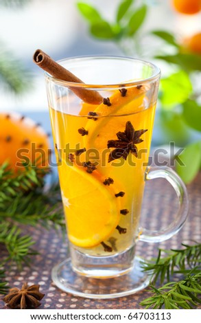 Orange   punch with fruit slices and spices.Hot drink for winter and Christmas - stock photo