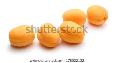 Orange ripe apricots on white - stock photo
