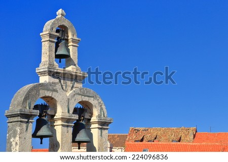 Orange roof tiles and bell tower of a church in the old town of Dubrovnik, Croatia - stock photo