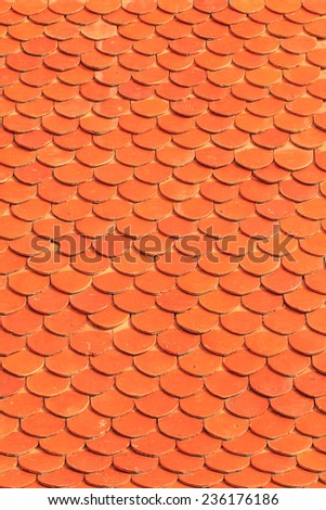 Orange roof tiles of a old built house - stock photo