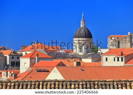 Orange roofs and church tower form the skyline of the old town of Dubrovnik, Croatia - stock photo