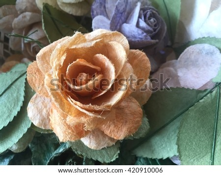 Orange rose flowers in mulberry paper texture with lighting at morning - stock photo