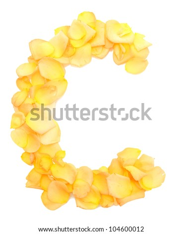 orange rose petals forming letter C, isolated on white