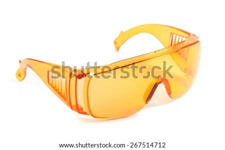 orange safety glasses isolated on white - stock photo