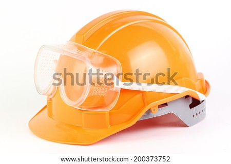 Orange Safety helmet and goggles isolated on white background - stock photo