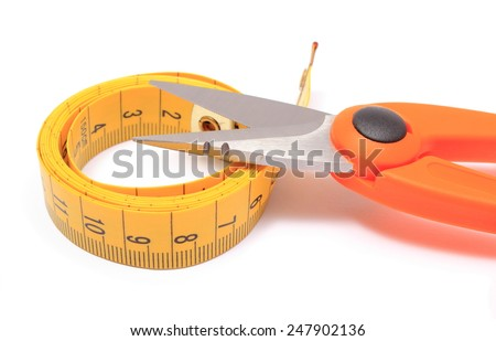 Orange Scissors with tape measure on white background, concept for slimming - stock photo