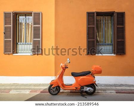 Orange scooter - stock photo