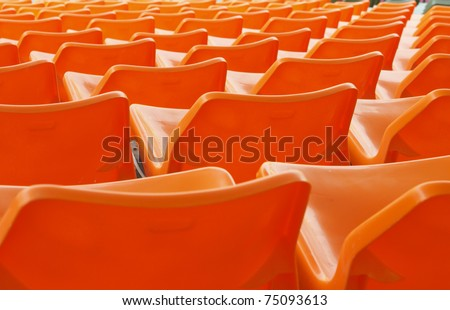 orange seat in stadium - stock photo