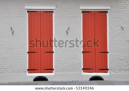 windows new orleans vinyl windows orange shuttered windows in new orleans french quarter stock photo royalty