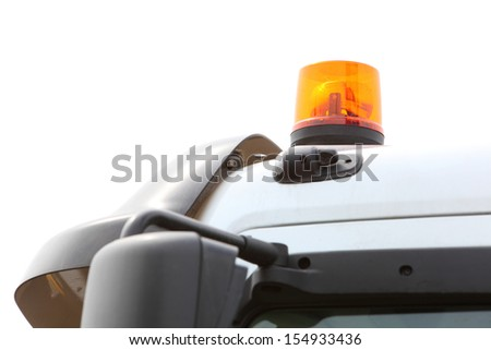 Orange siren signal lamp for warning, flashing light on vehicle, industry detail - stock photo