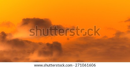 orange sky and dark clouds in front