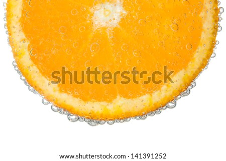 Orange Slice in Clear Fizzy Water Bubble Background Isolated - stock photo