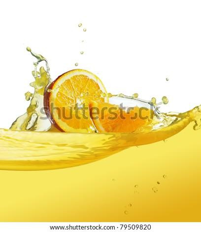 orange slice in juice stream - stock photo