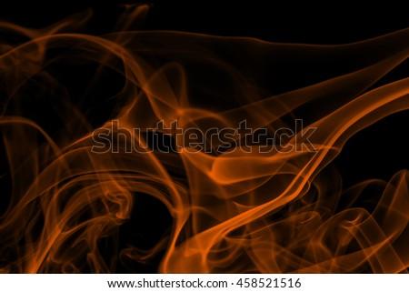 Orange smoke on black background, - stock photo