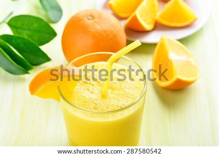 Orange smoothie in glass, close up view - stock photo