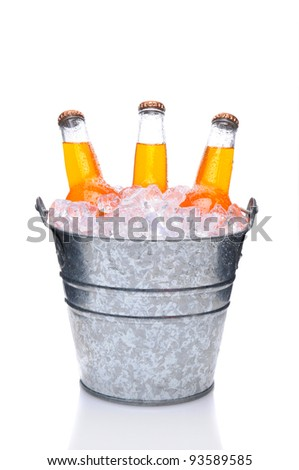 Orange Soda Bottles in a Bucket Filled with ice. Vertical Format over a white background with reflection. - stock photo