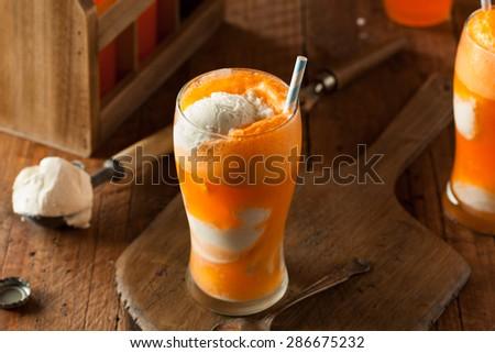 Orange Soda Creamsicle Ice Cream Float with a Straw - stock photo