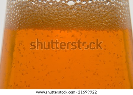 orange soda in glass bottle - stock photo