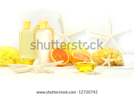 Orange spa products with candles