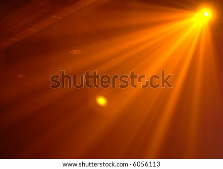 Orange spotlight on party - stock photo