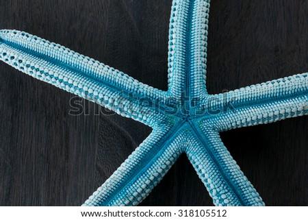 Orange starfish  on  rustic wooden boards  - stock photo