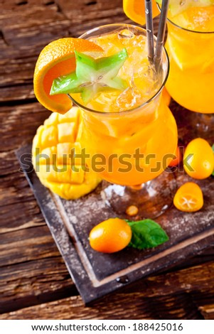 Orange summer coktails with exotic fruit, shot from upper view - stock photo