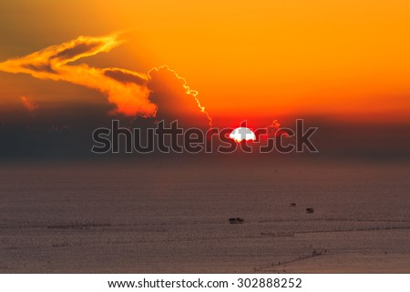 Orange sunset and cloud over the sea - stock photo