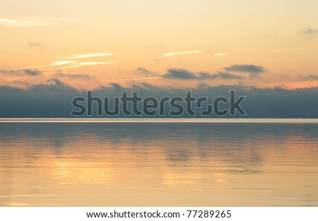 Orange sunset at the lake - stock photo