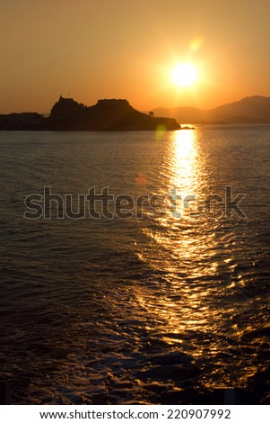 Orange sunset over Kerkyra town, Corfu, Greece - stock photo