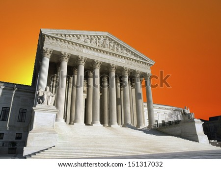 Orange sunset sky over the United States Supreme Court building in Washington DC. - stock photo