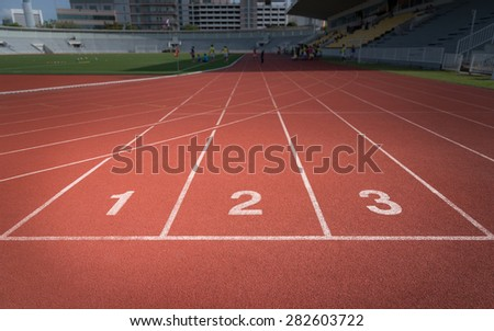 orange synthetic pavement,  running track number 1 - 3 - stock photo