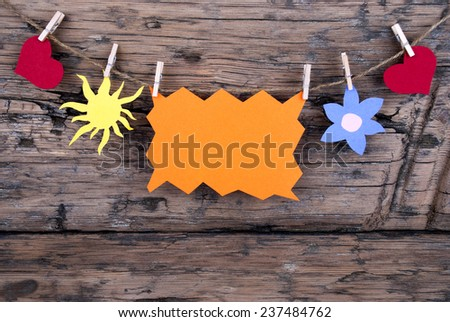 Orange Tag Or Label With Sun And Two Hearts And Flower On A Line With Copy Space Or Your Free Text Here On Wooden Background, Four Symbols, Vintage, Retro And Old Fashion Style - stock photo