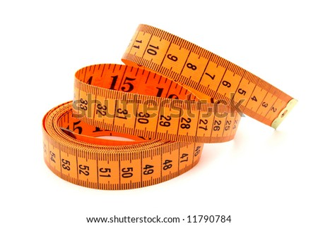 orange tape measure over a white surface - stock photo