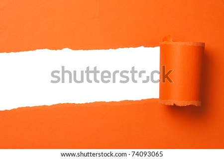 orange teared paper with copy space - stock photo