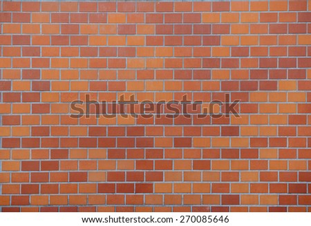 Orange tiled wall - stock photo