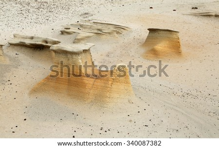 Orange toadstool coming out - Bisti/De-Na-Zin Wilderness Area - New Mexico - stock photo