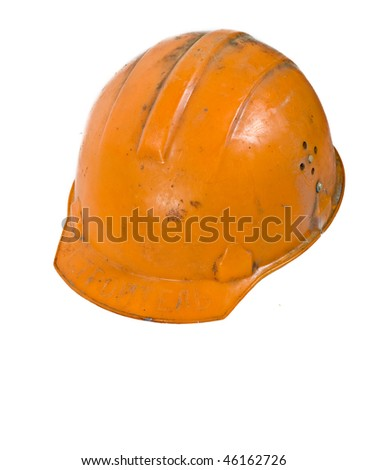 Orange used worker helmet isolated on white