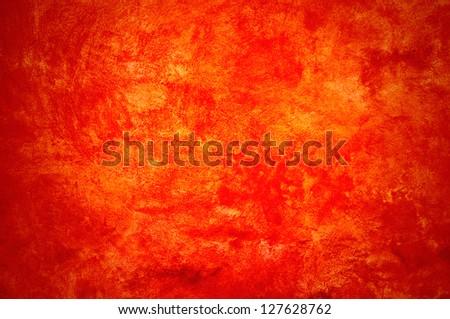 Orange wall with brush strokes. - stock photo