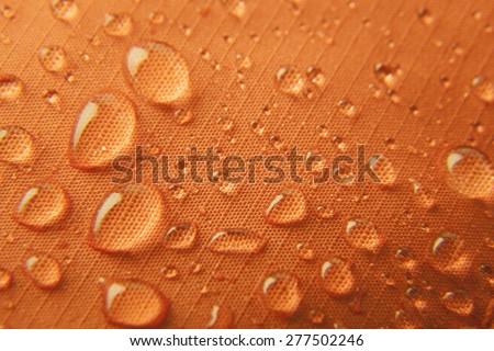 Orange waterproof textile background \ horizontal - stock photo
