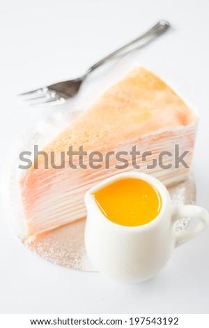 Orange whipped cream crepe cake on white background, stock photo - stock photo