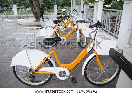 Orange white Public bicycles for rent in Waroros Market, Chiang Mai thailand - stock photo