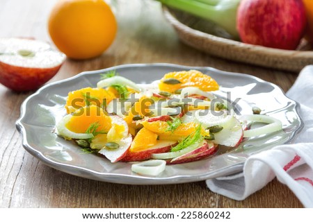 Orange with Apple and Fennel salad by fresh ingredients - stock photo