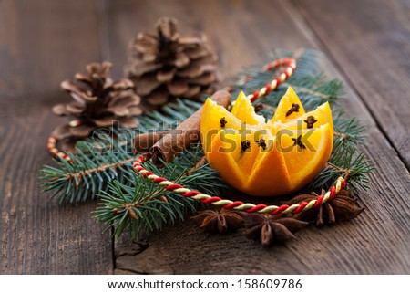 orange with gloves and decoration - stock photo