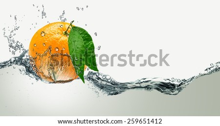 Orange with green leaves on a background of splashing water.  - stock photo