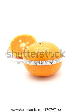 orange with measurement isolated on white - stock photo
