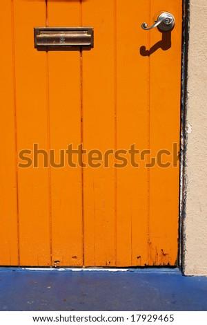 Orange wood door; Spanish Village Art Center; Balboa Park; San Diego, California - stock photo